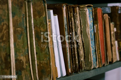 537881816 istock photo Ancient books are on the shelf 1154359542