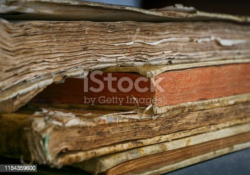 537881816 istock photo Ancient books are on the shelf 1154359600