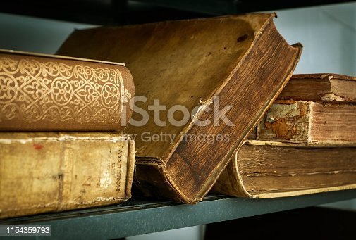537881816 istock photo Ancient books are on the shelf 1154359793