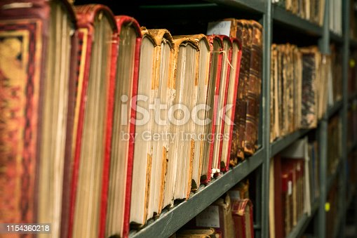 537881816 istock photo Ancient books are on the shelf 1154360218