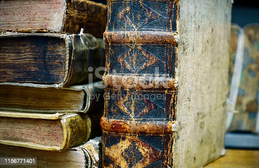 537881816 istock photo Ancient books are on the shelf 1156771401