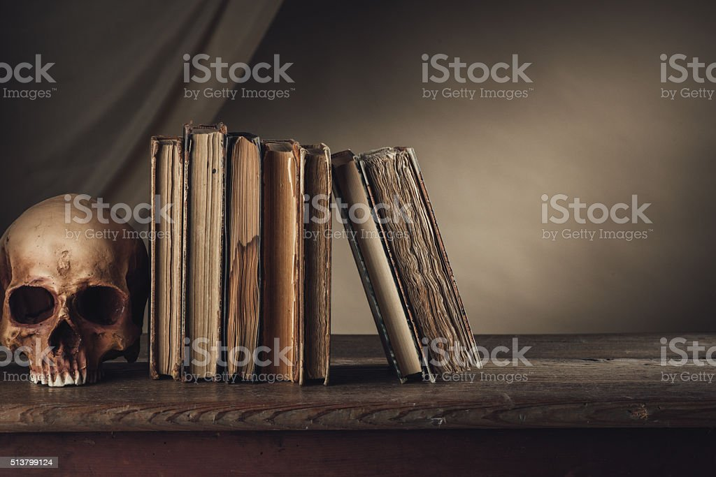 Ancient books with skull stock photo