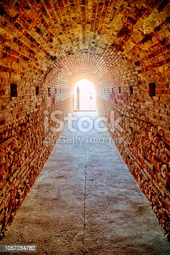 Ancient brick tunnel with daily light in the end