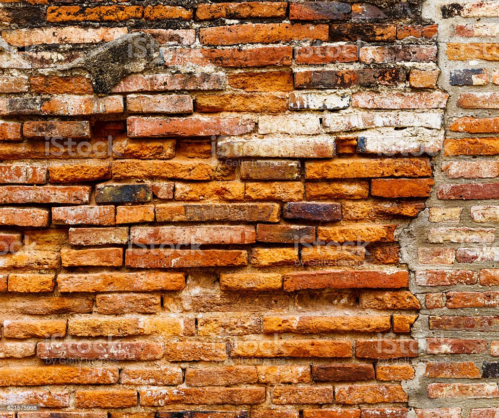 Ancient brick wall in red color photo libre de droits