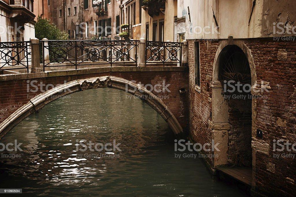 Ancient Bridge Along Venice Italy Canal royalty-free stock photo