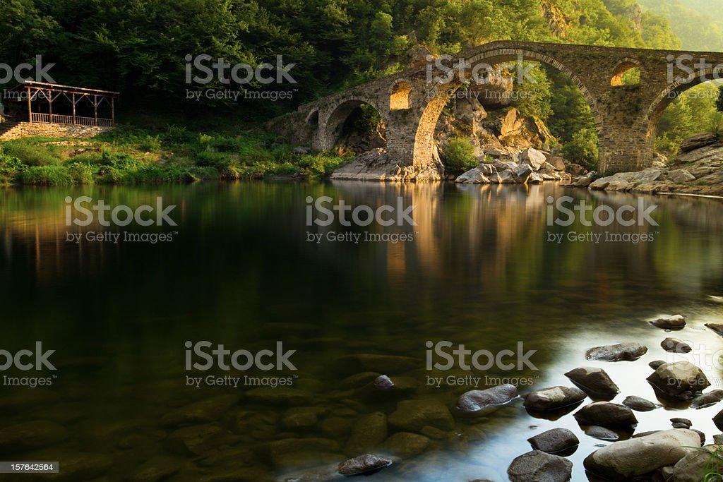 Ancient bridge over river in Bulgaria royalty-free stock photo