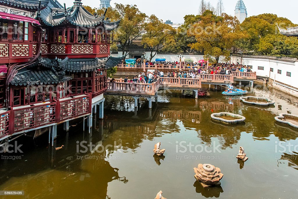 Ancient bridge with modern skyscraper in background, Shanghai, China stock photo