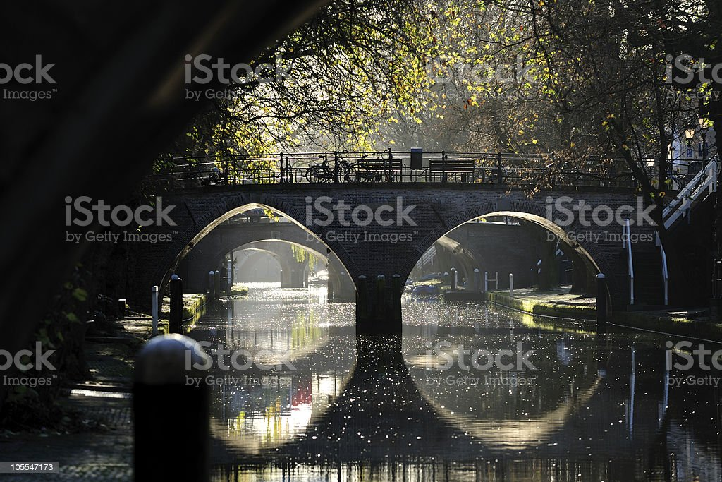 Ancient bridges over canal Oudegracht in Utrecht the Netherlands stock photo
