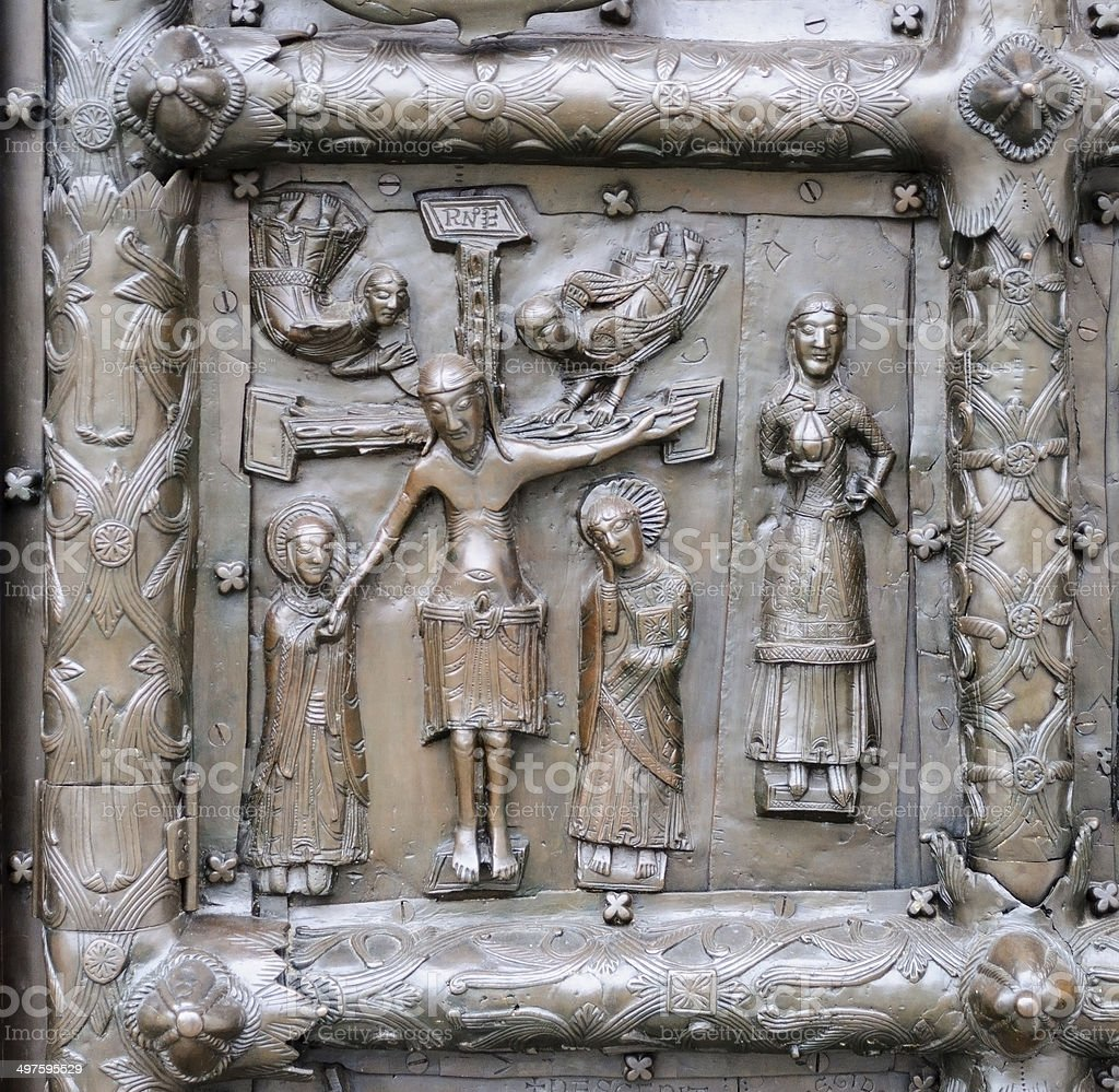Ancient bronze gates with Jesus Christ crucified on the cross royalty-free stock photo