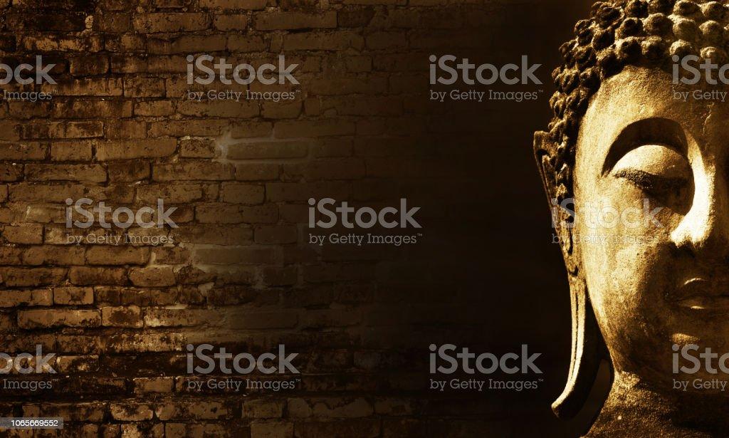 Ancient Buddha face in Ayutthaya, Thailand stock photo