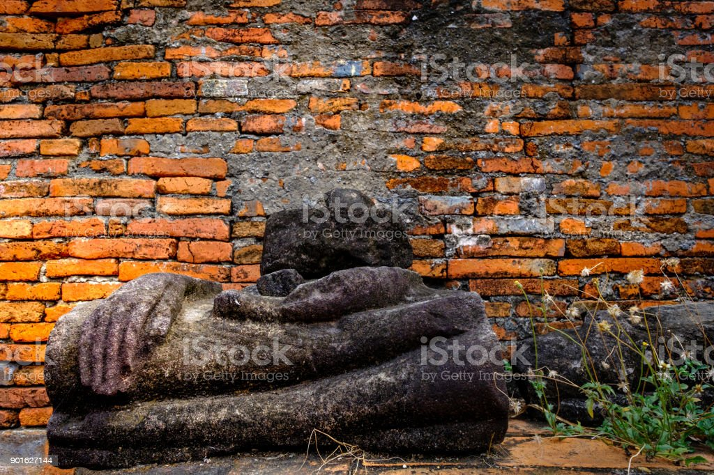 Ancient Buddha ruins and old brick wall on ancient monuments that are over 200 years old. Wat Nakhon Luang Tample,Prasat Nakhon Luang public domain or treasure of Buddhism in Nakornluang, Ayutthaya, Thailand stock photo