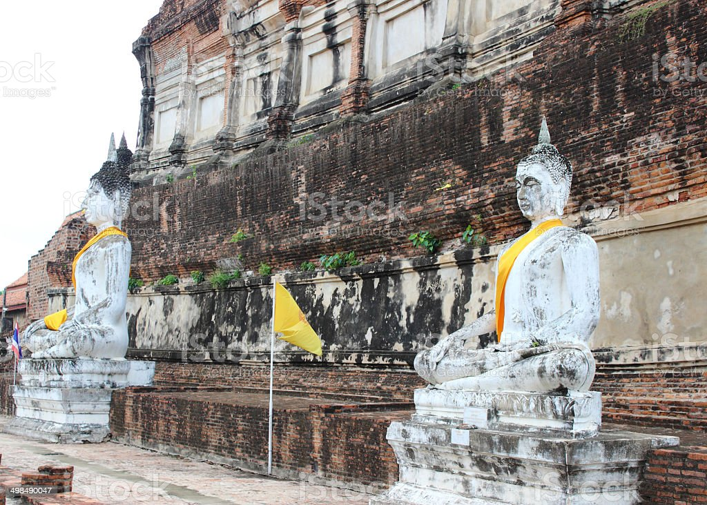 Ancient Buddha statues at Wat Yai Chai Mongkol in Ayutthaya stock photo