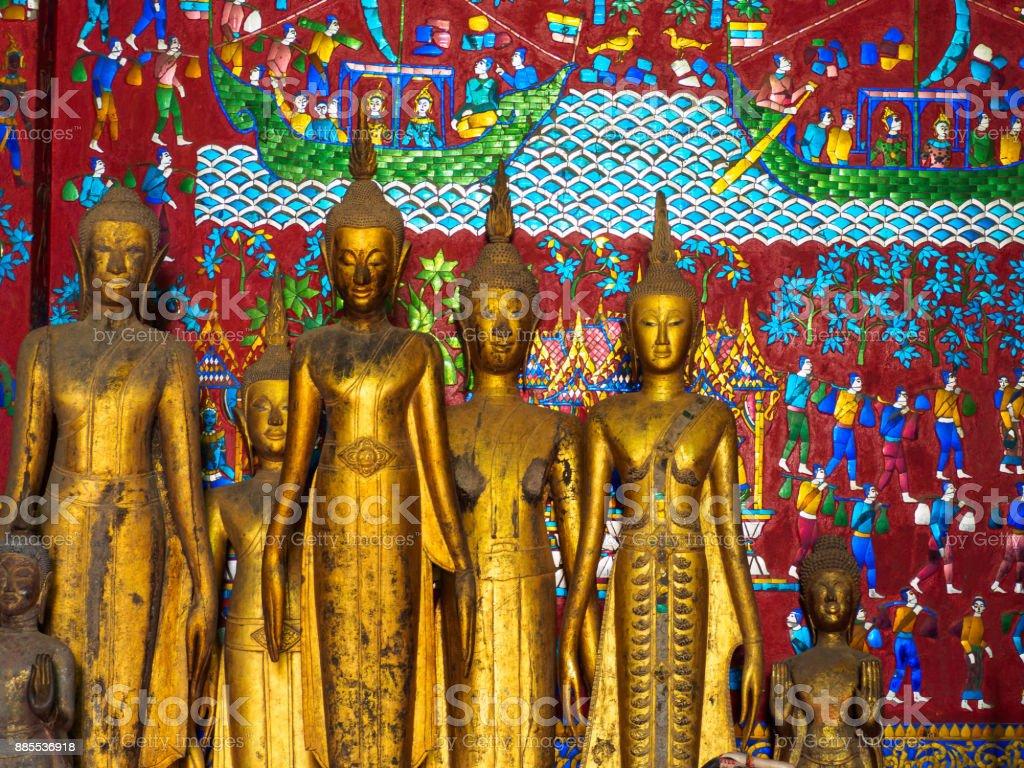 Ancient Buddha statues of Wat Xieng Thong Luang Prabang Laos stock photo