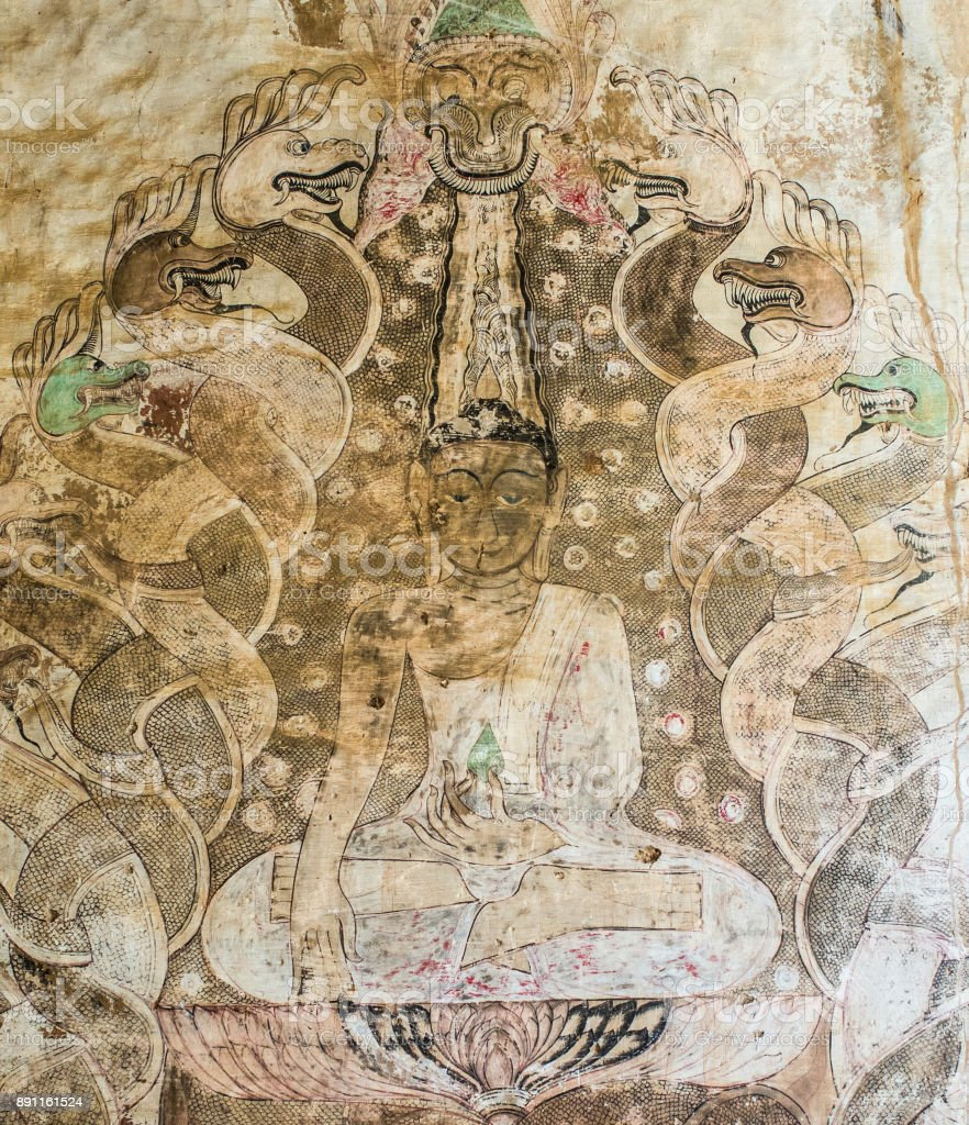 Ancient Buddha with snakes painting in a Burmese mural inside the Sulamani Temple stock photo