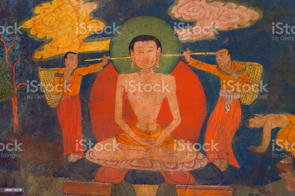 Ancient buddhist fresco at the wall of  Basgo Gompa. stock photo