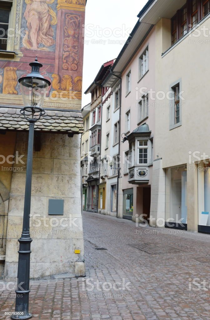 ancient building and shopping street in Switzerland stock photo