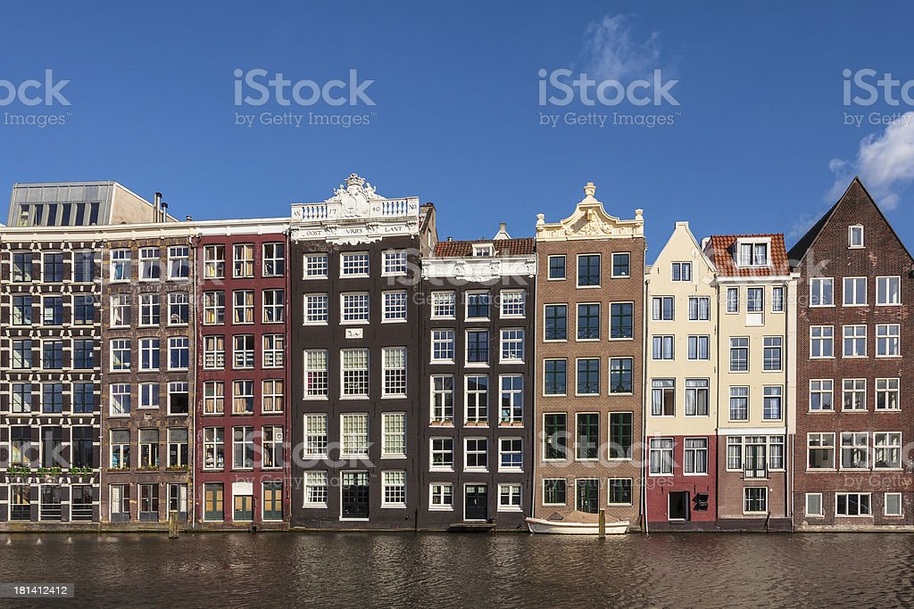 Ancient canal houses in the Dutch capital city Amsterdam royalty-free stock photo