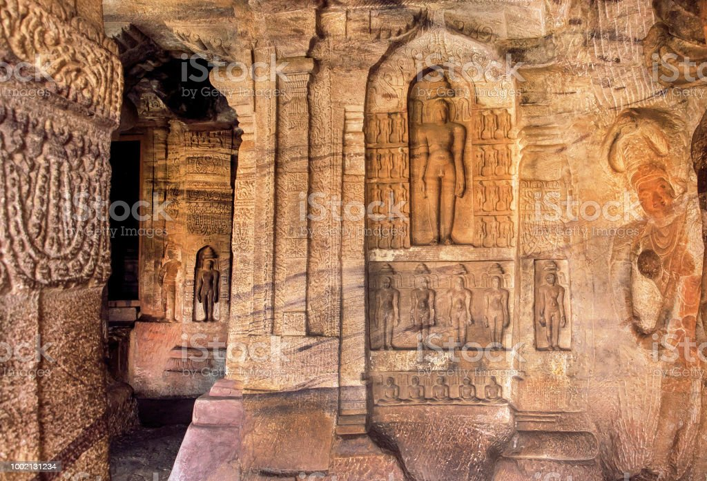 Ancient carvings and sculptures of India. Inside the 7th century cave temple in Karnataka, India stock photo