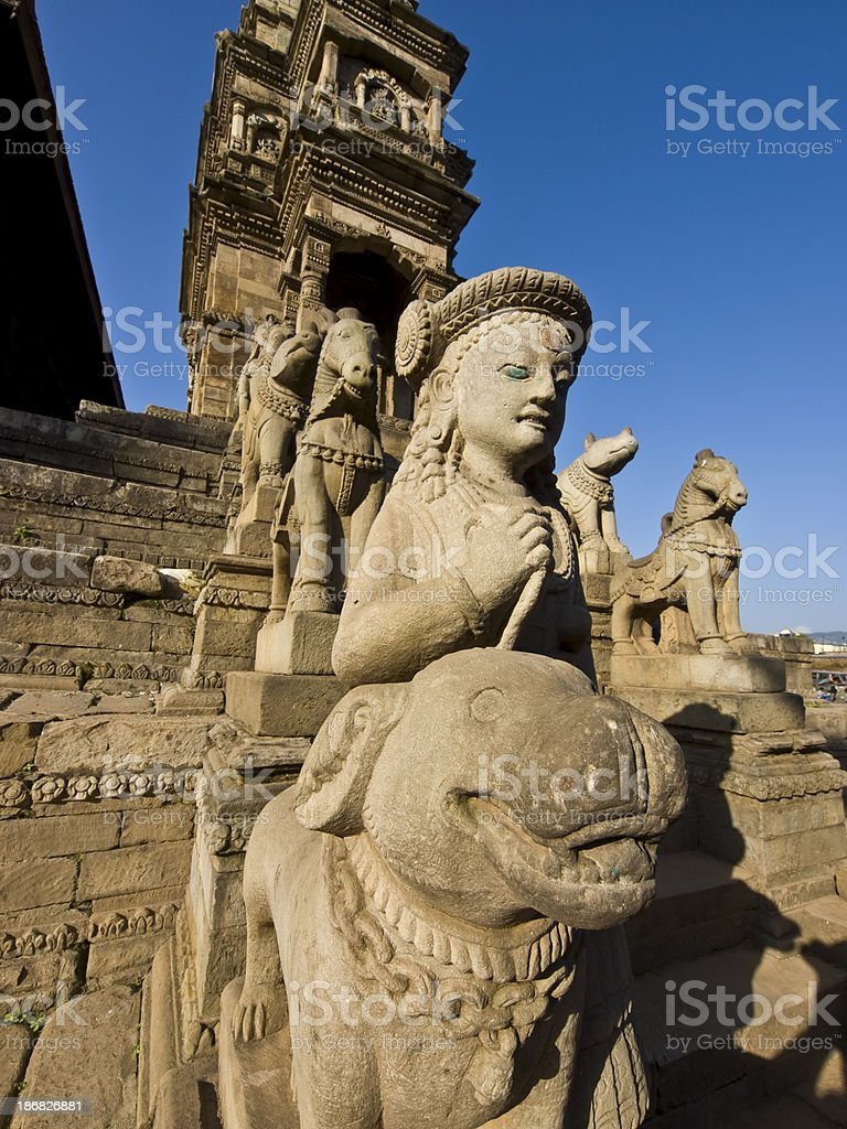 Ancient carvings of woman and horses on stone steps royalty-free stock photo