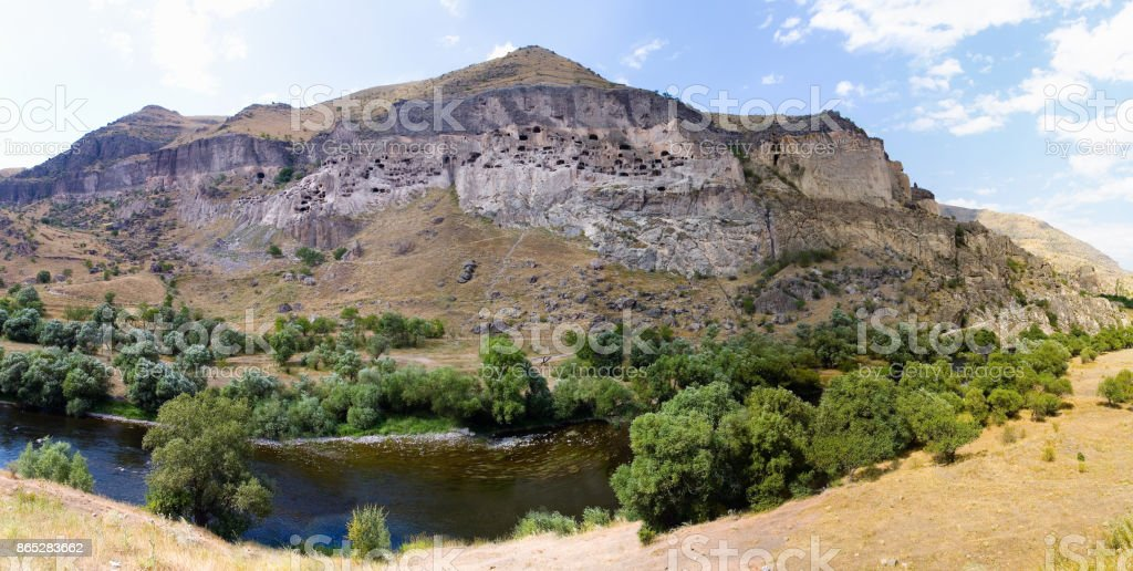 Ancient cave city in Georgia and the river Kura. stock photo
