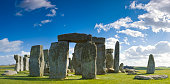 Stonehenge on a bright summer day with blue sky and green grass vertical