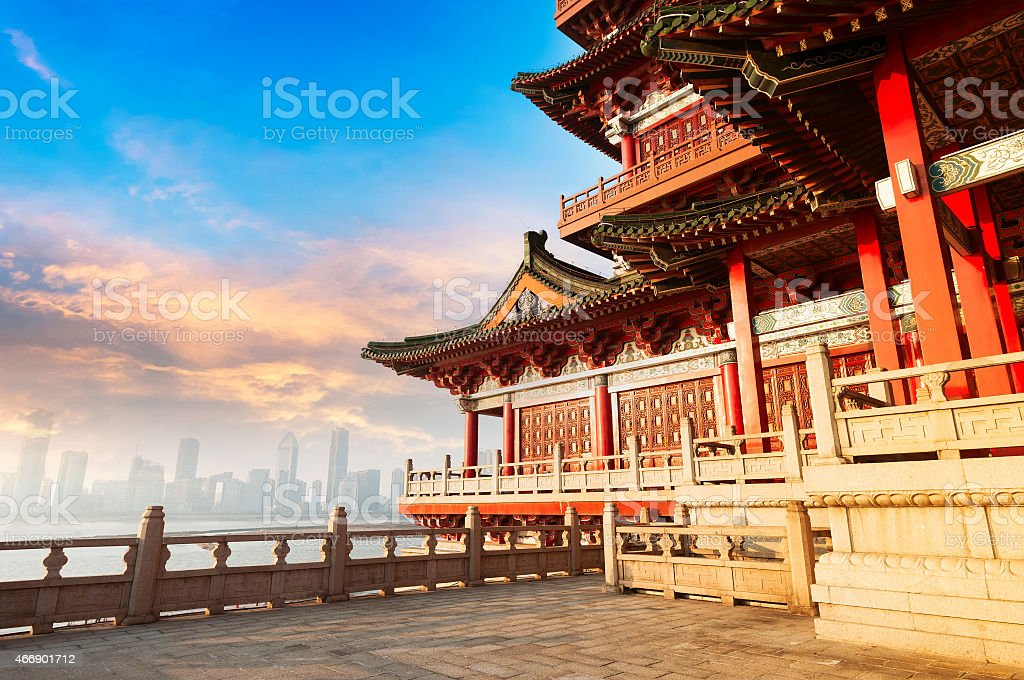 Ancient Chinese architecture with city skyline in background stock photo