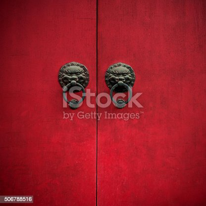 Ancient Chinese door with knockers.
