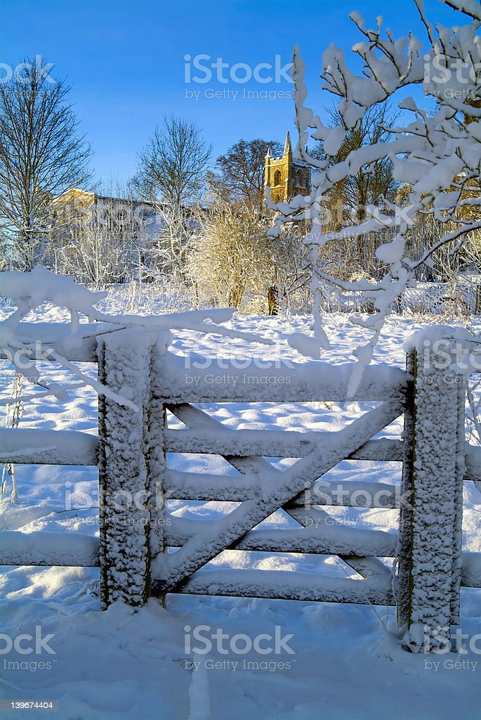 Ancient church and gate in the snow royalty-free stock photo