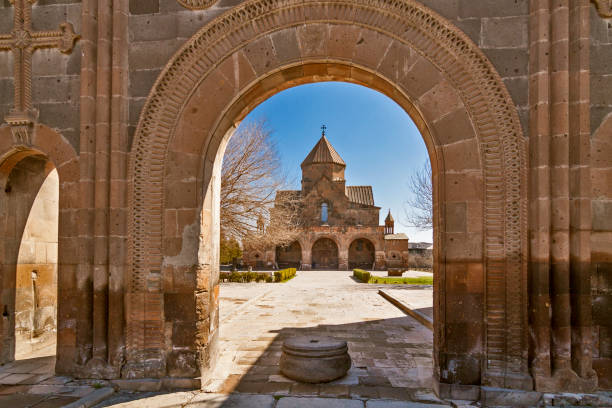 Ancient church of Saint Gayane in Etchmiadzin, Armenia Armenia - Etchmiadzin (Vagharshapat) - 7th-century church of Saint Gayane taken through the arch of the church fence tuff stock pictures, royalty-free photos & images
