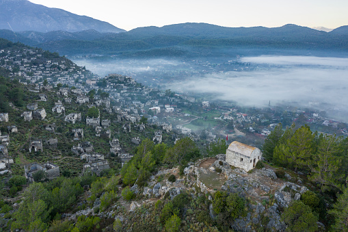 Ancient church on the hill and abandoned Village of Kayakoy in Fethiye. Muğla / Turkey. Taken via done.