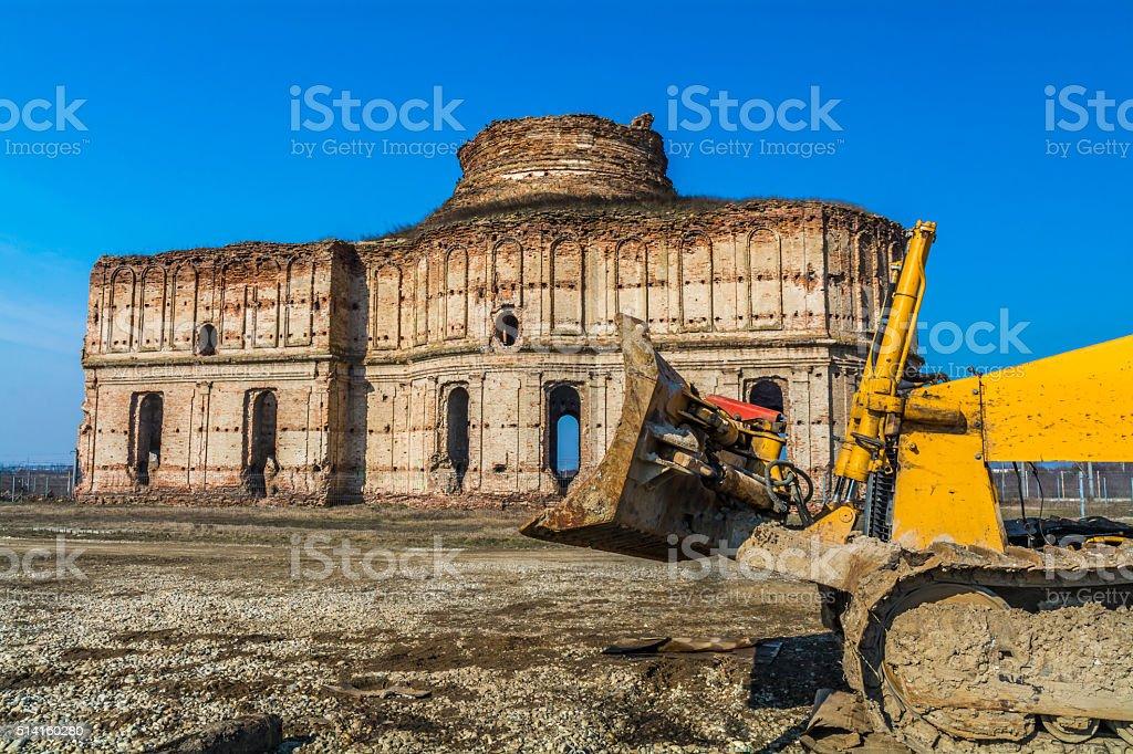 Ancient church ruins beeing demolished stock photo