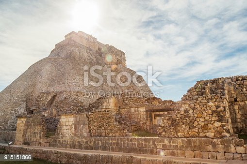 istock Ancient city in the jungle. Mayan temple Uxmal archeological site, ruins in Yucatan. Pyramid of the Magician (Piramide del adivino) in ancient Mayan city Uxmal, Mexico 915151866