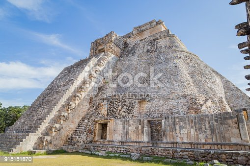 istock Ancient city in the jungle. Mayan temple Uxmal archeological site, ruins in Yucatan. Pyramid of the Magician (Piramide del adivino) in ancient Mayan city Uxmal, Mexico 915151870