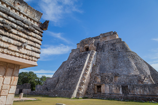istock Ancient city in the jungle. Mayan temple Uxmal archeological site, ruins in Yucatan. Pyramid of the Magician (Piramide del adivino) in ancient Mayan city Uxmal, Mexico 915151876