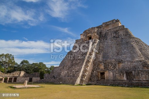 istock Ancient city in the jungle. Mayan temple Uxmal archeological site, ruins in Yucatan. Pyramid of the Magician (Piramide del adivino) in ancient Mayan city Uxmal, Mexico 915151878