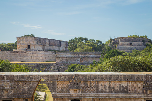 istock Ancient city in the jungle. Mayan temple Uxmal archeological site, ruins in Yucatan. Pyramid of the Magician (Piramide del adivino) in ancient Mayan city Uxmal, Mexico 915151884