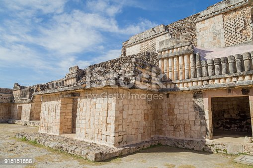 istock Ancient city in the jungle. Mayan temple Uxmal archeological site, ruins in Yucatan. Pyramid of the Magician (Piramide del adivino) in ancient Mayan city Uxmal, Mexico 915151886