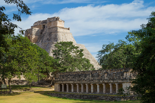 istock Ancient city in the jungle. Mayan temple Uxmal archeological site, ruins in Yucatan. Pyramid of the Magician (Piramide del adivino) in ancient Mayan city Uxmal, Mexico 915151896