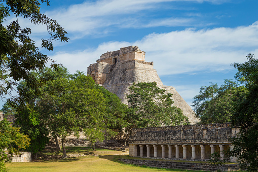 istock Ancient city in the jungle. Mayan temple Uxmal archeological site, ruins in Yucatan. Pyramid of the Magician (Piramide del adivino) in ancient Mayan city Uxmal, Mexico 915151900