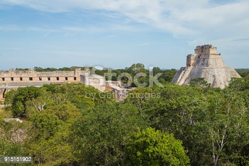 istock Ancient city in the jungle. Mayan temple Uxmal archeological site, ruins in Yucatan. Pyramid of the Magician (Piramide del adivino) in ancient Mayan city Uxmal, Mexico 915151902