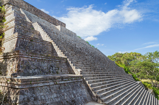 istock Ancient city in the jungle. Mayan temple Uxmal archeological site, ruins in Yucatan. Pyramid of the Magician (Piramide del adivino) in ancient Mayan city Uxmal, Mexico 915151918