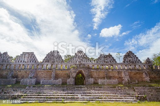 istock Ancient city in the jungle. Mayan temple Uxmal archeological site, ruins in Yucatan. Pyramid of the Magician (Piramide del adivino) in ancient Mayan city Uxmal, Mexico 915151920