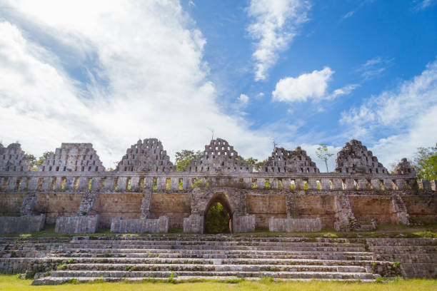 ancient city in the jungle. mayan temple uxmal archeological site, ruins in yucatan. pyramid of the magician (piramide del adivino) in ancient mayan city uxmal, mexico - uxmal stock photos and pictures