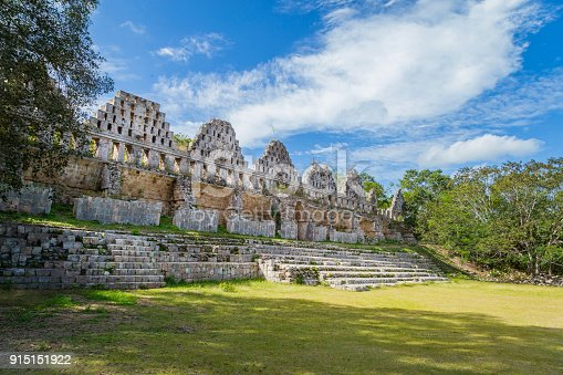 istock Ancient city in the jungle. Mayan temple Uxmal archeological site, ruins in Yucatan. Pyramid of the Magician (Piramide del adivino) in ancient Mayan city Uxmal, Mexico 915151922