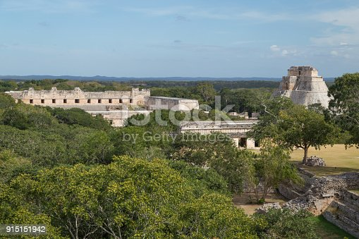 istock Ancient city in the jungle. Mayan temple Uxmal archeological site, ruins in Yucatan. Pyramid of the Magician (Piramide del adivino) in ancient Mayan city Uxmal, Mexico 915151942