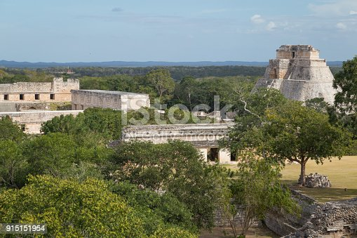 istock Ancient city in the jungle. Mayan temple Uxmal archeological site, ruins in Yucatan. Pyramid of the Magician (Piramide del adivino) in ancient Mayan city Uxmal, Mexico 915151954