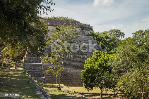 istock Ancient city in the jungle. Mayan temple Uxmal archeological site, ruins in Yucatan. Pyramid of the Magician (Piramide del adivino) in ancient Mayan city Uxmal, Mexico 915152284