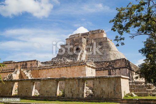 istock Ancient city in the jungle. Mayan temple Uxmal archeological site, ruins in Yucatan. Pyramid of the Magician (Piramide del adivino) in ancient Mayan city Uxmal, Mexico 915152296