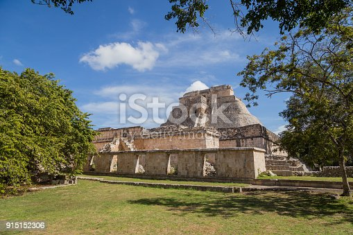 istock Ancient city in the jungle. Mayan temple Uxmal archeological site, ruins in Yucatan. Pyramid of the Magician (Piramide del adivino) in ancient Mayan city Uxmal, Mexico 915152306