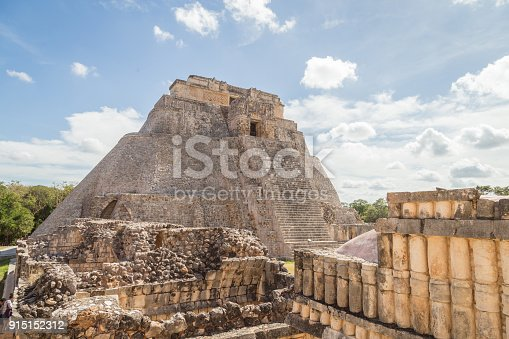 istock Ancient city in the jungle. Mayan temple Uxmal archeological site, ruins in Yucatan. Pyramid of the Magician (Piramide del adivino) in ancient Mayan city Uxmal, Mexico 915152312